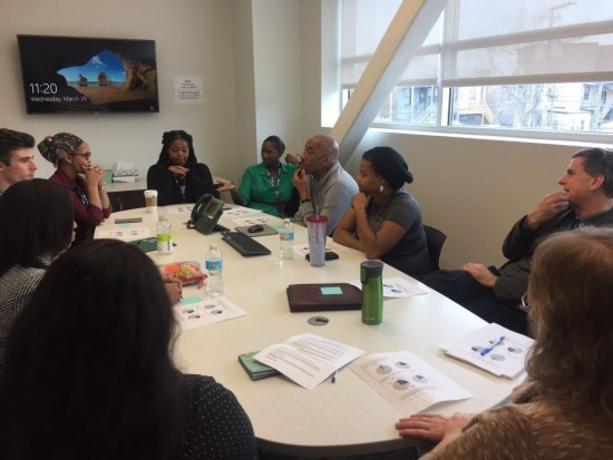 UCAN staff gather to discuss how to challenge gender bias and engage young people in the conversation about equity.